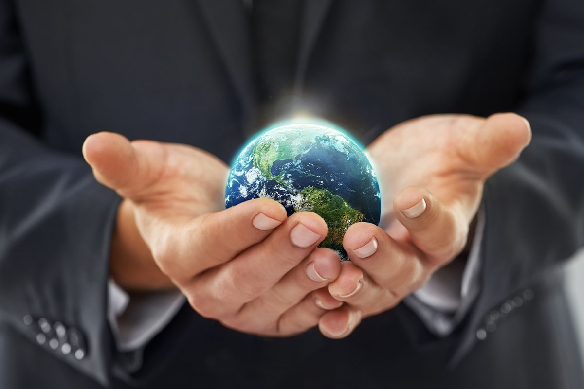 close up of hands holding a small globe