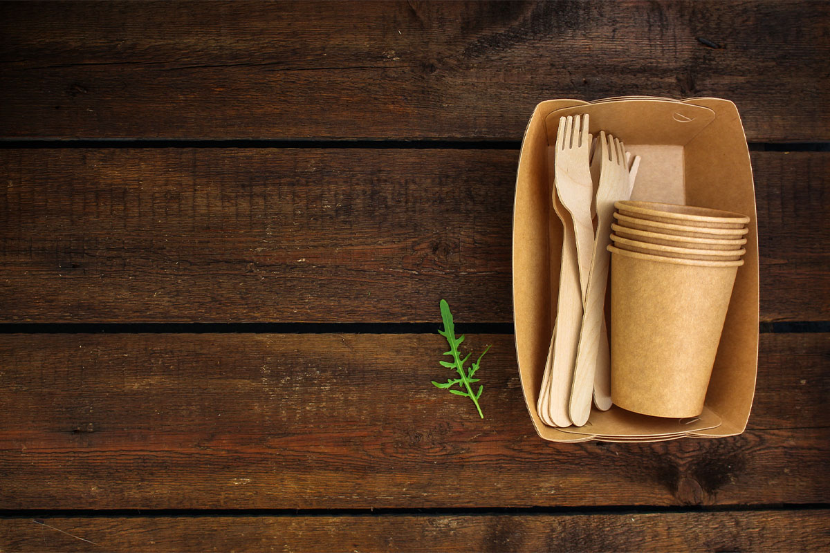 Recyclable utensils on a wooden table.