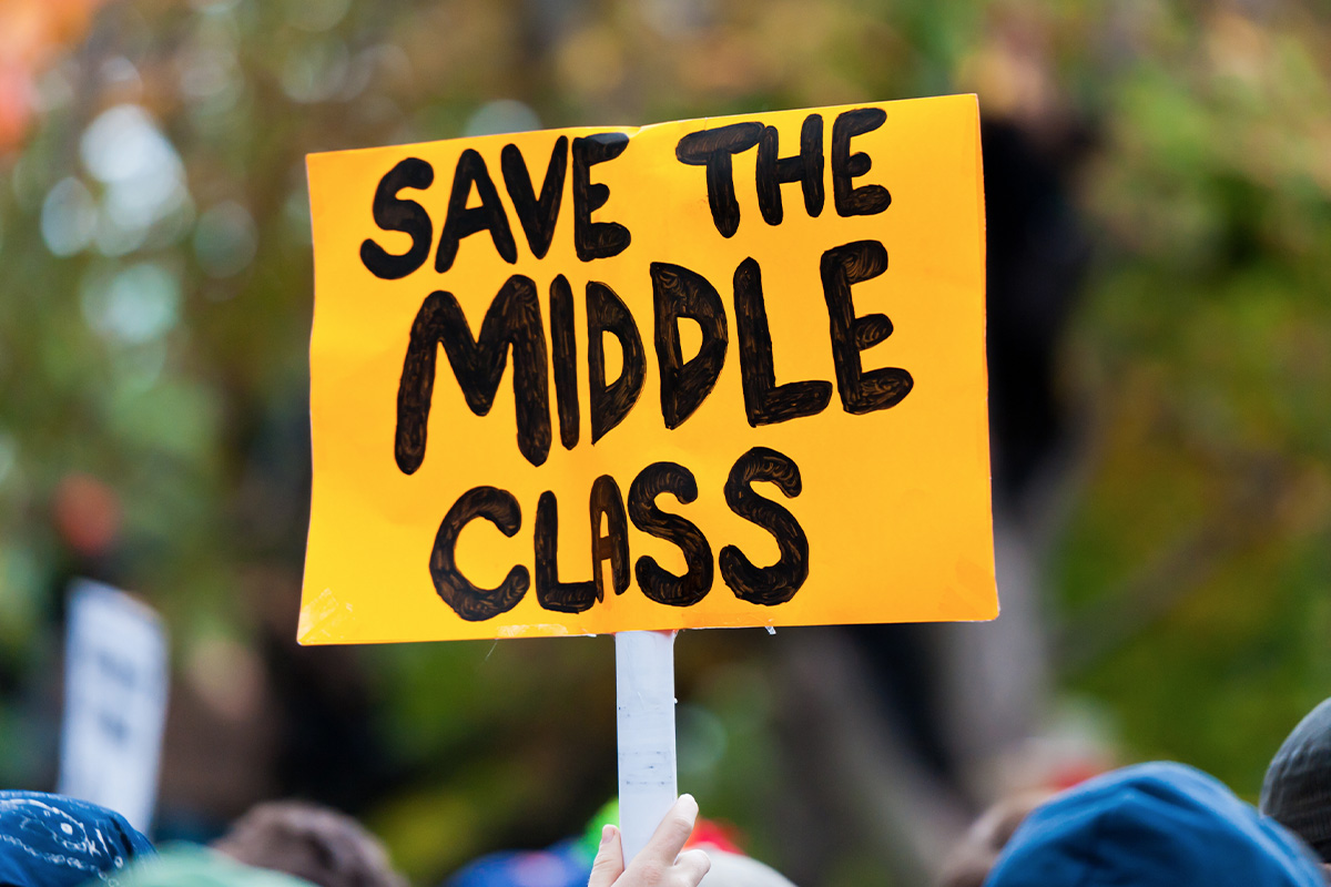 A yellow protestor's sign that reads Save the Middle Class