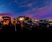 People sitting in their parked cars at Easton's drive-in movies